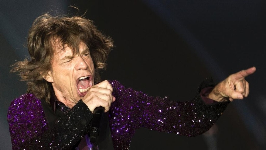 FILE - In this June 4, 2014 file photo, Rolling Stones singer Mick Jagger performs during a concert in Hayrkon Park in Tel Aviv, Israel. In whatís fast becoming something of a modern World Cup tradition, Brazilians are closely following every team the 70-year-old rock star supports with an eye for mocking the alleged spell he casts on every team he picks. Brazilian media has taken to calling his pick, Jaggerís ìpe frio,î a term describing the bad luck he brings teams that translates literally as ìcold foot.î(AP Photo/Ariel Schalit, File)