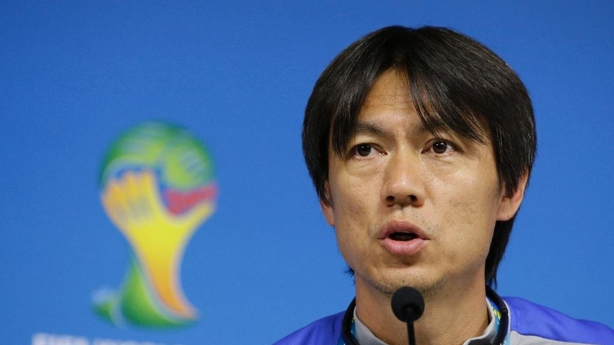 South Korea national soccer team coach Hong Myung-bo answers reporter's question during a press conference the day before the group H World Cup soccer match between South Korea and Belgium at the Itaquerao Stadium in Sao Paulo, Brazil, Wednesday, June 25, 2014.  (AP Photo/Lee Jin-man)