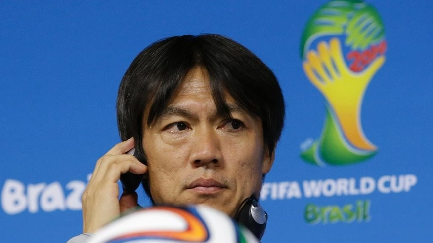 South Korea national soccer team coach Hong Myung-bo listens to reporter's question during a press conference the day before the group H World Cup soccer match between South Korea and Belgium at the Itaquerao Stadium in Sao Paulo, Brazil, Wednesday, June 25, 2014.  (AP Photo/Lee Jin-man)