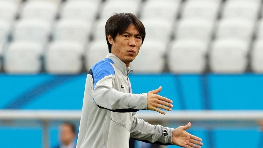 South Korea national soccer team coach Hong Myung-bo checks the stadium during an official training session the day before the group H World Cup soccer match between South Korea and Belgium at the Itaquerao Stadium in Sao Paulo, Brazil, Wednesday, June 25, 2014. (AP Photo/Lee Jin-man)