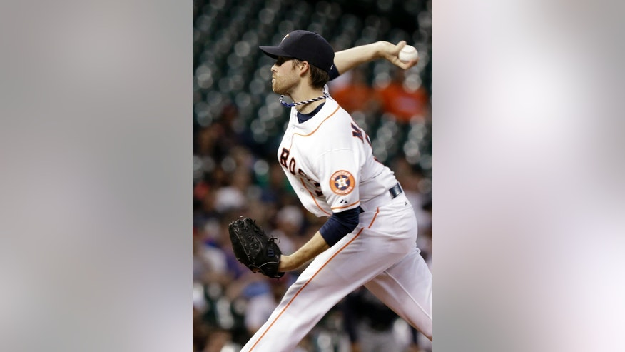 Houston Astros' Collin McHugh delivers a pitch against the Atlanta Braves in the first inning of a baseball game Wednesday, June 25, 2014, in Houston. (AP Photo/Pat Sullivan)