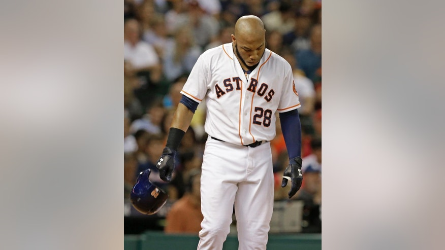 Houston Astros' Jon Singleton drops his helmet after striking out to end the sixth inning and stranding two base runners in the sixth inning of a baseball game against the Atlanta Braves, Wednesday, June 25, 2014, in Houston. (AP Photo/Pat Sullivan)