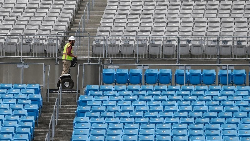 A worker uses a Segway to get around at the Carolina Panthers' home football field, Bank of America Stadium, in Charlotte, N.C., Wednesday, June 25, 2014. The stadium has been undergoing renovations which are expected to be completed this summer. (AP Photo/Chuck Burton)