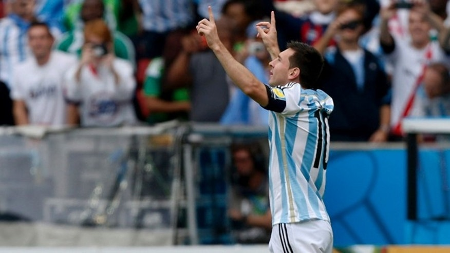 Argentina's Lionel Messi celebrates after scoring his side's first goal during the group F World Cup soccer match against Nigeria at the Estadio Beira-Rio in Porto Alegre, Brazil, Wednesday, June 25, 2014. (AP Photo/Martin Meissner)(AP Photo/Jon Super)