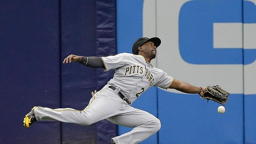 Pittsburgh Pirates center fielder Andrew McCutchen dives but can't make the catch on a triple by Tampa Bay Rays' Ben Zobrist during the first inning of an interleague baseball game Wednesday, June 25, 2014, in St. Petersburg, Fla. (AP Photo/Chris O'Meara)