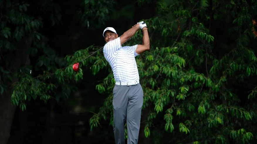Tiger Woods watches his tee shot on the sixth hole during the Pro-Am at the Quicken Loans National golf tournament, Wednesday, June 25, 2014, in Bethesda, Md. (AP Photo/Nick Wass)