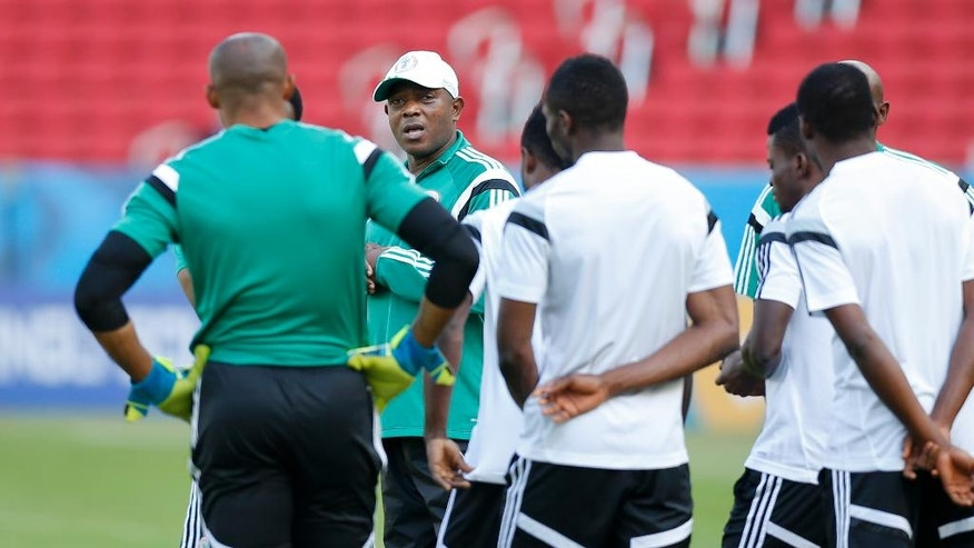 Nigeria's coach Stephen Keshi, second left, speaks to players at the start of a training session at Beira-Rio Stadium in Porto Alegre, Brazil, Tuesday, June 24, 2014.  Nigeria plays in group F of the 2014 soccer World Cup. (AP Photo/Victor R. Caivano)
