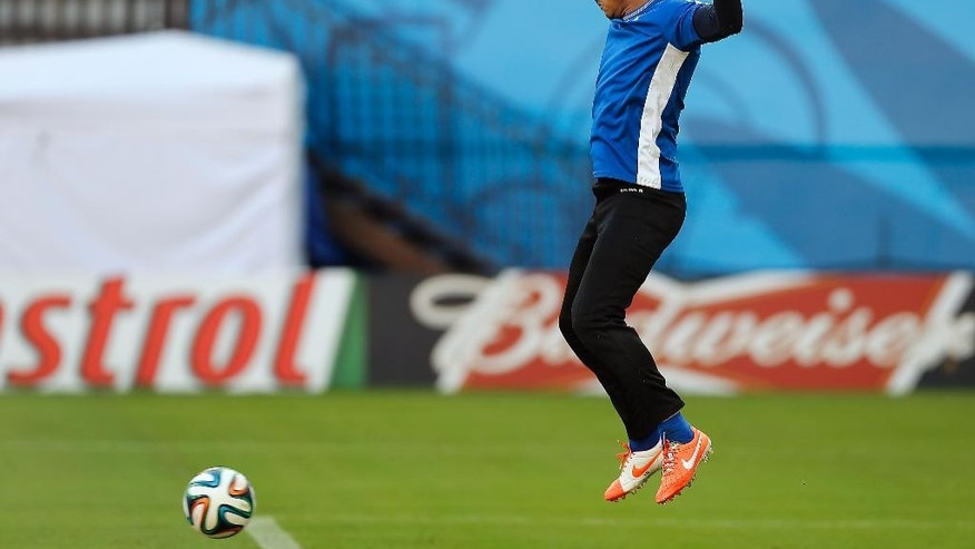 Honduras' goalkeeper Luis Lopez jumps during a training session at the Arena da Amazonia in Manaus, Brazil, Tuesday, June 24, 2014, one day before the group E match between Honduras and Switzerland of the 2014 soccer World Cup. (AP Photo/Frank Augstein)