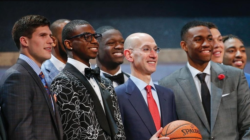 NBA commissioner Adam Silver, center, poses for a group photo with top NBA Draft prospects before the start of the 2014 NBA Draft, Thursday, June 26, 2014, in New York. (AP Photo/Jason DeCrow)