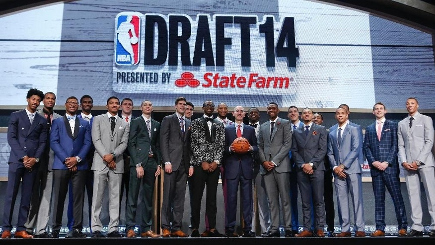 NBA commissioner Adam Silver, center, poses for a photo with top NBA Draft prospects before the start of the 2014 NBA Draft, Thursday, June 26, 2014, in New York. (AP Photo/Kathy Willens)