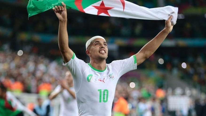 Algeria's Sofiane Feghouli celebrates after the group H World Cup soccer match between Algeria and Russia at the Arena da Baixada in Curitiba, Brazil, Thursday, June 26, 2014. The match ended in a 1-1 draw, but Algeria qualified for the round of 16. (AP Photo/Ivan Sekretarev)