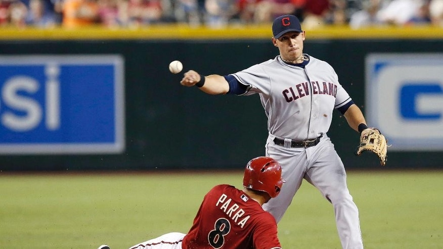 Cleveland Indians' Asdrubal Cabrera, right, throws to first after forcing out Arizona Diamondbacks' Gerardo Parra (8) during the first inning of a baseball game on Wednesday, June 25, 2014, in Phoenix. Miguel Montero was out at first on the double play. (AP Photo/Ross D. Franklin)