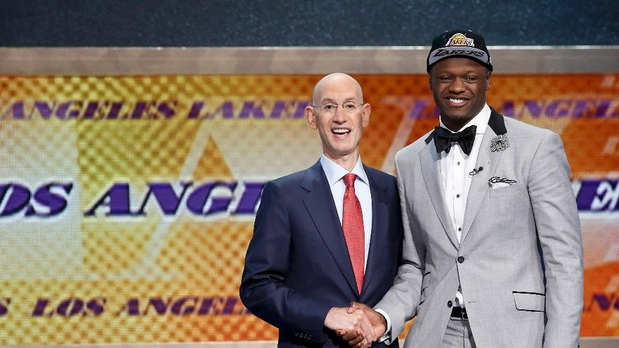 Kentucky forward Julius Randle, right, poses for a photo with NBA commissioner Adam Silver after being selected seventh overall by the Los Angeles Lakers during the 2014 NBA draft, Thursday, June 26, 2014, in New York. (AP Photo/Kathy Willens)