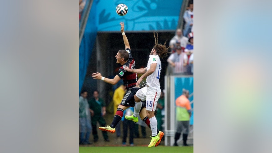 CORRECTS ID TO KYLE BECKERMAN, NOT JERMAINE JONES - United States' Kyle Beckerman goes up against Germany's Bastian Schweinsteiger during the group G World Cup soccer match between the USA and Germany at the Arena Pernambuco in Recife, Brazil, Thursday, June 26, 2014. (AP Photo/Ricardo Mazalan)