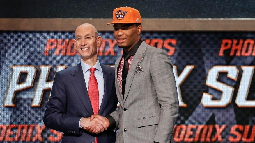 North Carolina State's T.J. Warren, right, poses for a photo with NBA Commissioner Adam Silver after being selected 14th overall by the Phoenix Suns during the 2014 NBA draft, Thursday, June 26, 2014, in New York. (AP Photo/Jason DeCrow)