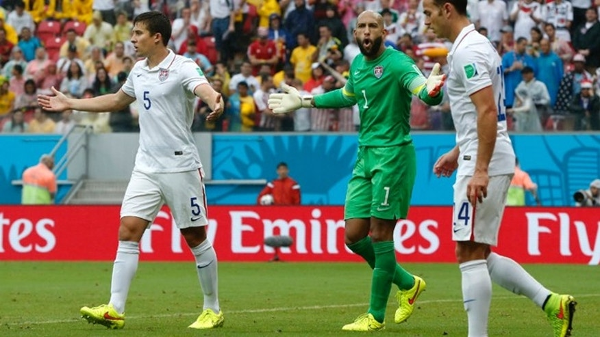 United States' goalkeeper Tim Howard, center, argues with his defense during the group G World Cup soccer match between the USA and Germany at the Arena Pernambuco in Recife, Brazil, Thursday, June 26, 2014. (AP Photo/Matthias Schrader)