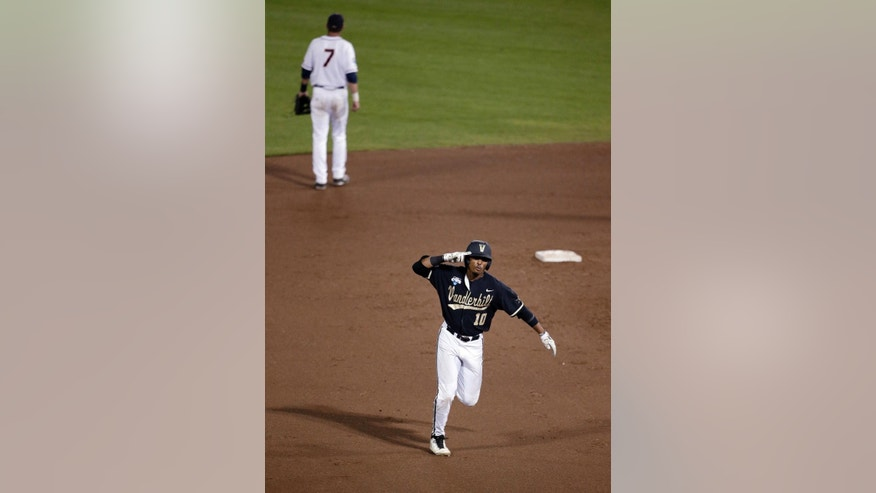 Vanderbilt's John Norwood celebrates as he runs the bases after hitting a home run against Virginia in the eighth inning of Game 3 of the best-of-three NCAA baseball College World Series finals in Omaha, Neb., Wednesday, June 25, 2014. (AP Photo/Nati Harnik)