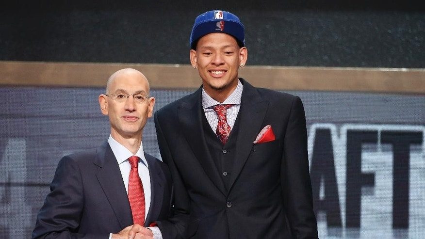 Baylor center Isaiah Austin, right, poses for a photo with NBA Commissioner Adam Silver after being granted ceremonial first round pick during the 2014 NBA draft, Thursday, June 26, 2014, in New York. Austin, who was projected to be a first round selection was diagnosed with Marfan syndrome just four days before the draft. (AP Photo/Jason DeCrow)