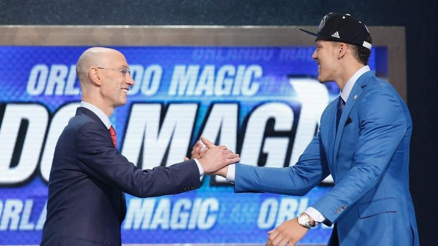 Arizona forward Aaron Gordon is greeted by NBA Commissioner Adam Silver after being selected fourth overall by the Orlando Magic during the 2014 NBA draft, Thursday, June 26, 2014, in New York. (AP Photo/Kathy Willens)
