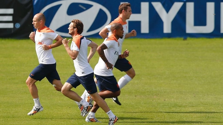 Seen from left to right, Arjen Robben, Daley Blind, Nigel de Jong, and Stefan de Vrij of the Netherlands train in group separate from the rest of their team in Rio de Janeiro, Brazil, Thursday, June 26, 2014.  Netherlands will play Group A runner-up Mexico in the second round on Sunday in Fortaleza. (AP Photo/Wong Maye-E)