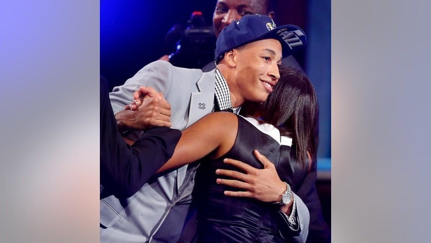 Dante Exum, left, hugs friends and family after being selected by the Utah Jazz as the fifth overall pick during the 2014 NBA draft, Thursday, June 26, 2014, in New York. (AP Photo/Jason DeCrow)