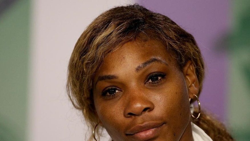 Serena Williams of the U.S attends a press conference after losing to Alize Cornet of France at the All England Lawn Tennis Championships in Wimbledon, London, Saturday June 28, 2014. (AP Photo/AELTC, Scott Heavey)