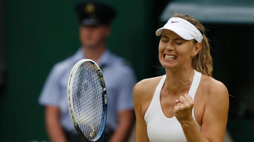 Maria Sharapova of Russia celebrates after winning a game against Alison Riske of U.S. during their women's singles match on Centre Court at the All England Lawn Tennis Championships in Wimbledon, London, Saturday, June 28, 2014. (AP Photo/Ben Curtis)