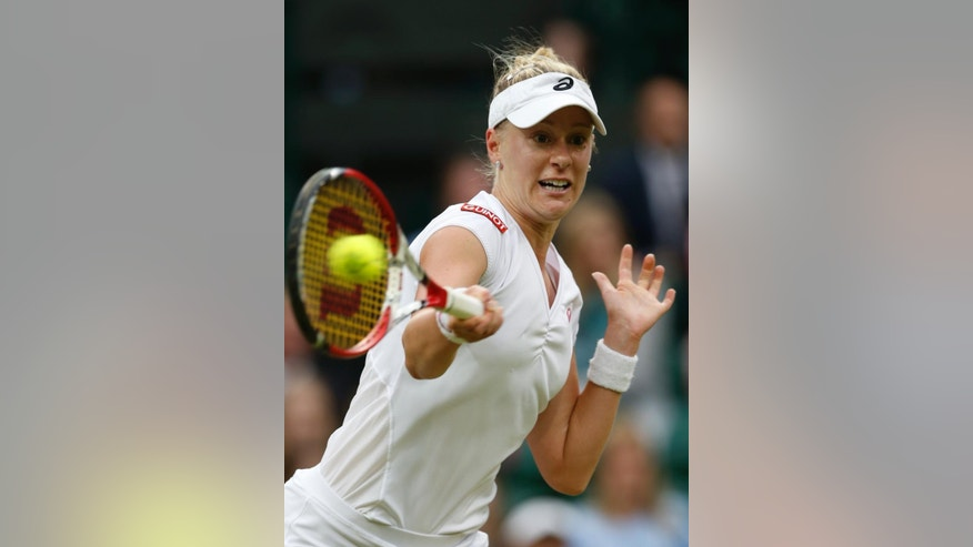 Alison Riske of U.S. plays a return to Maria Sharapova of Russia during their women's singles match at the All England Lawn Tennis Championships in Wimbledon, London, Saturday, June 28, 2014. (AP Photo/Ben Curtis)