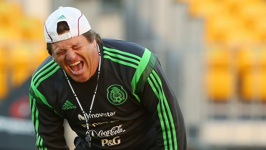 WELLINGTON, NEW ZEALAND - NOVEMBER 19:  Coach Miguel Herrera of Mexico enjoys a laugh during a Mexico training session and press conference at Westpac Stadium on November 19, 2013 in Wellington, New Zealand.  (Photo by Hagen Hopkins/Getty Images)