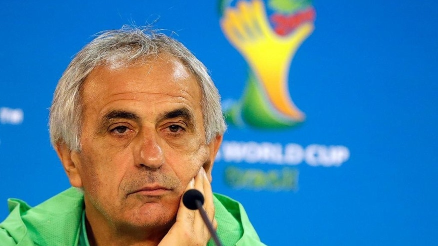 Algeria's head coach Vahid Halilhodzic listens during a press conference at the Estadio Beira-Rio Stadium in Porto Alegre, Brazil, Sunday, June 29, 2014.  Algeria will play Germany in a World Cup round of 16 soccer match on June 30. (AP Photo/Kirsty Wigglesworth)