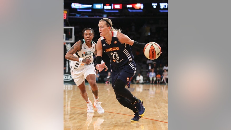 Connecticut Sun's Katie Douglas, right, dribbles past New York Liberty guard Cappie Pondexter during the first half of a WNBA basketball game at Madison Square Garden in New York, Sunday, June 29, 2014. (AP Photo/John Minchillo)