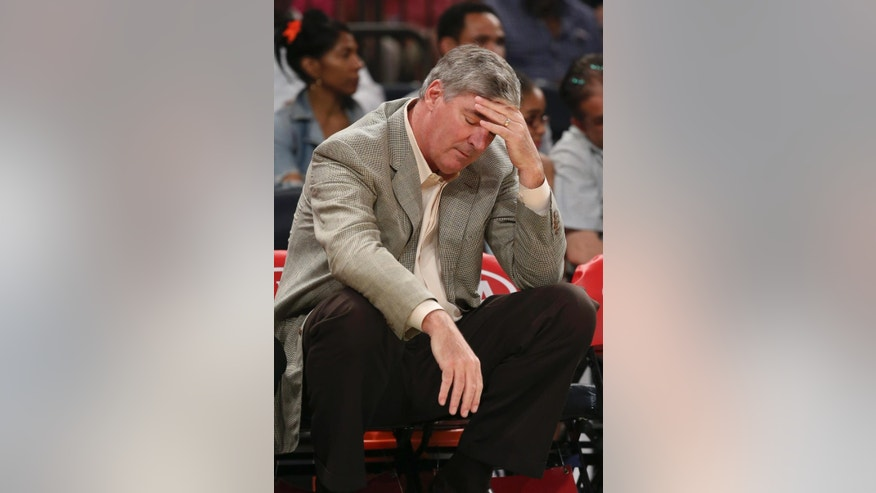 New York Liberty head coach Bill Laimbeer reacts on the bench during the first half of a WNBA basketball game against the Connecticut Sun at Madison Square Garden in New York, Sunday, June 29, 2014. (AP Photo/John Minchillo)
