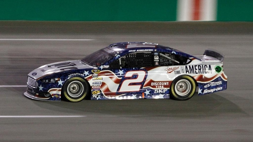 Brad Keselowski drives on the way to winning the NASCAR Sprint Cup series auto race Saturday, June  28, 2014, at Kentucky Speedway in Sparta, Ky. (AP Photo/James Crisp)