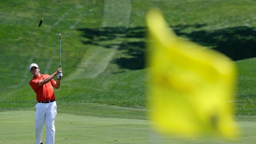 Ben Martin is seen past the first pin as he hits from the fairway during the final round of the Quicken Loans National PGA golf tournament, Sunday, June 29, 2014, in Bethesda, Md. (AP Photo/Patrick Semansky)
