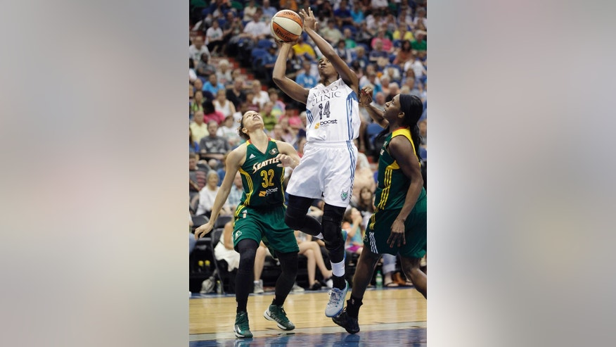 Minnesota Lynx forward Devereaux Peters (14) pushes up to the basket against Seattle Storm forward Alysha Clark (32) and forward Crystal Langhorne, right, in the first half of a WNBA basketball game, Sunday, June 29, 2014, in Minneapolis. (AP Photo/Stacy Bengs)