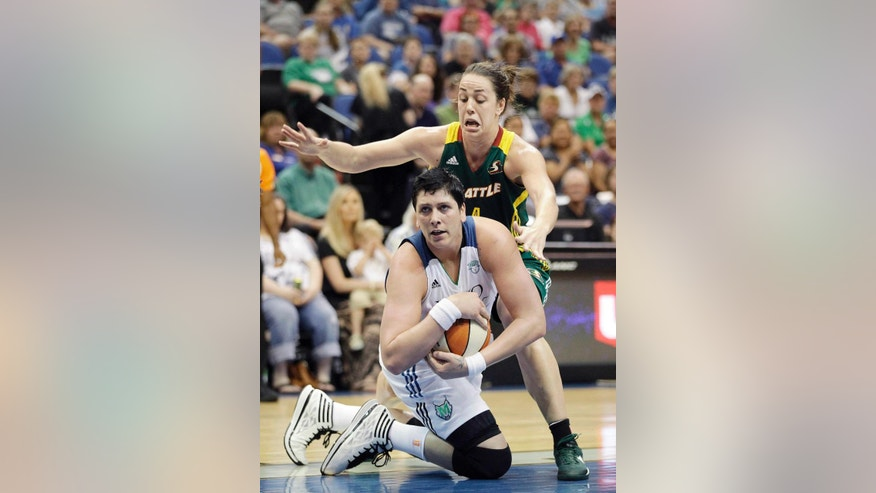 Minnesota Lynx center Janel McCarville (4) calls a timeout after gaining possession of the ball against Seattle Storm guard Jenna O'Hea (4) in the first half of a WNBA basketball game, Sunday, June 29, 2014, in Minneapolis. (AP Photo/Stacy Bengs)