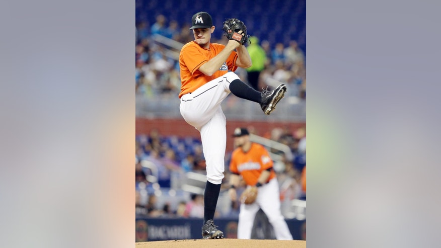Miami Marlins' Andrew Heaney delivers a pitch during the first inning of a baseball game against the Oakland Athletics, Sunday, June 29, 2014 in Miami. (AP Photo/Wilfredo Lee)
