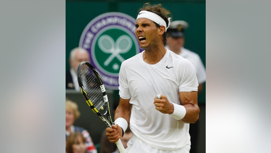 Rafael Nadal of Spain clenches his fist after winning a game against Mikhail Kukushkin of Kazakhstan during their men's singles match on Centre Court at the All England Lawn Tennis Championships in Wimbledon, London, Saturday, June 28, 2014. (AP Photo/Ben Curtis)