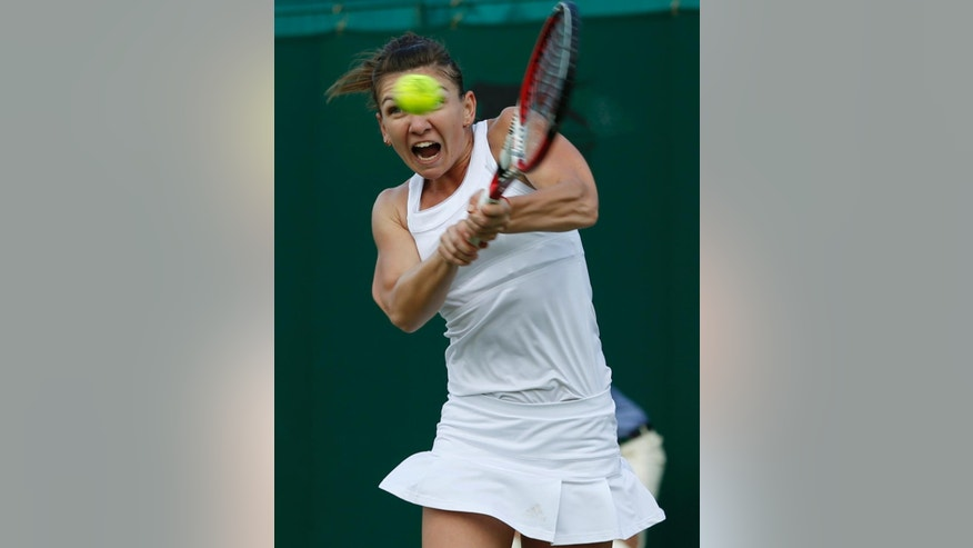 Simona Halep of Romania plays a return to Belinda Bencic of Switzerland during their women's singles match at the All England Lawn Tennis Championships in Wimbledon, London, Saturday, June 28, 2014. (AP Photo/Alastair Grant)