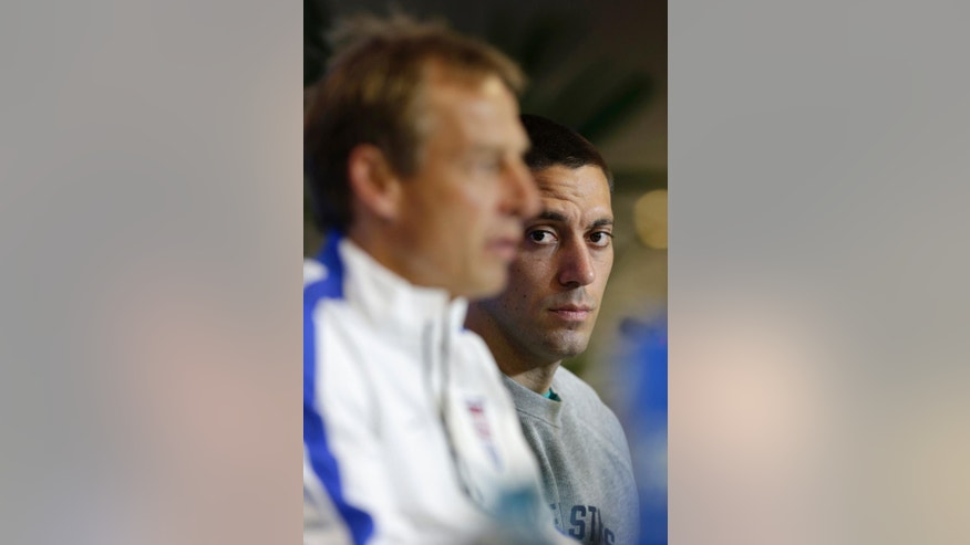 United States' head coach Jurgen Klinsmann, left, speaks as attacking player Clint Dempsey listens during a press conference the day before the World Cup round of 16 soccer match between Belgium and the U.S. at Arena Fonte Nova in Salvador, Brazil, Monday, June 30, 2014. (AP Photo/Julio Cortez)