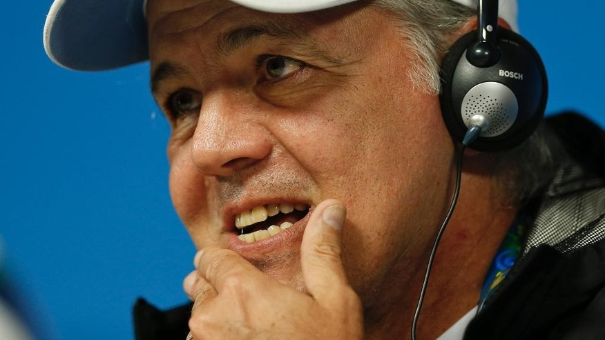 Argentina's head coach Alejandro Sabella listens to a question during a news conference at Itaquerao Stadium in Sao Paulo, Brazil, Monday, June 30, 2014. Argentina will face Switzerland in their next World Cup soccer match, Tuesday.  (AP Photo/Victor R. Caivano)