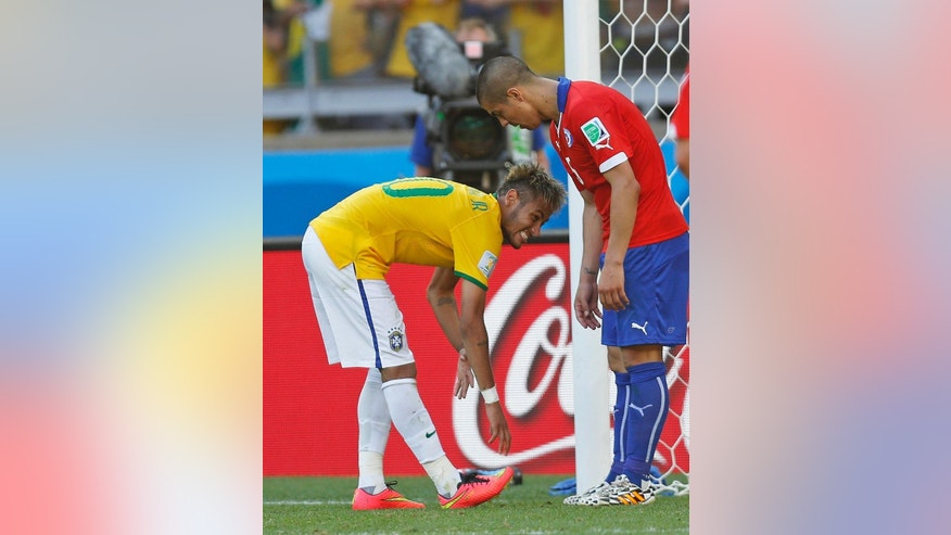 Brazil's Neymar reacts during the World Cup round of 16 soccer match between Brazil and Chile at the Mineirao Stadium in Belo Horizonte, Brazil, Saturday, June 28, 2014. (AP Photo/Frank Augstein)