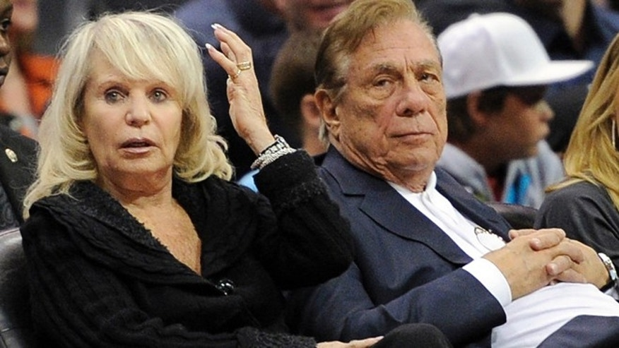 In this Nov. 12, 2010, file photo, Los Angeles Clippers owner Donald T. Sterling, right, sits with his wife Rochelle during the Clippers NBA basketball game against the Detroit Pistons in Los Angeles. (AP)