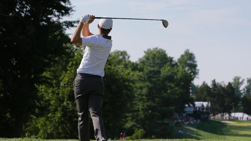 Justin Rose, of England, tees off on the 15th hole during the final round of the Quicken Loans National PGA golf tournament, Sunday, June 29, 2014, in Bethesda, Md. Rose beat Shawn Stefani in a one-hole playoff round to win the tournament. (AP Photo/Patrick Semansky)