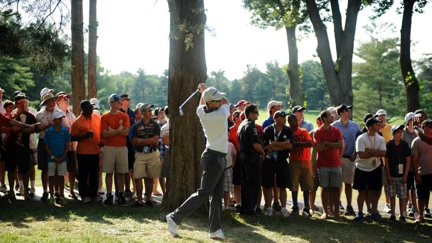 Justin Rose, of England, watches his shot from the rough on the 18th  hole during the final round of the Quicken Loans National golf tournament, Sunday, June 29, 2014, in Bethesda, Md. (AP Photo/Nick Wass)