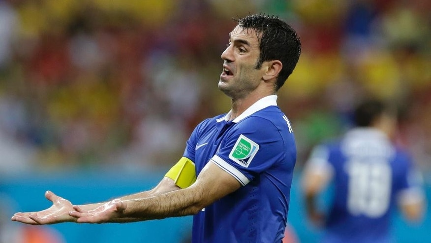 Greece's Giorgos Karagounis reacts during the World Cup round of 16 soccer match between Costa Rica and Greece at the Arena Pernambuco in Recife, Brazil, Sunday, June 29, 2014. (AP Photo/Ricardo Mazalan)
