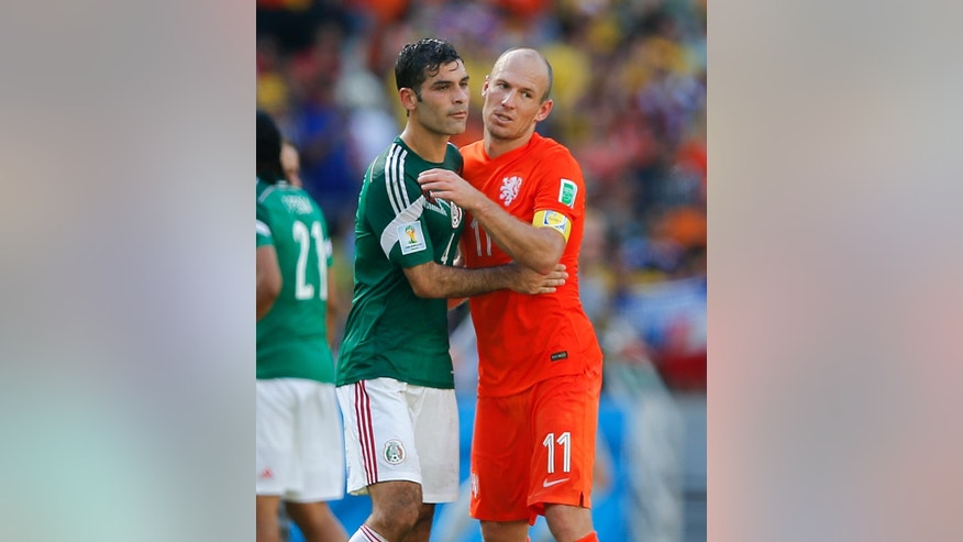 Netherlands' Arjen Robben, right, talks to Mexico's Rafael Marquez after the Netherlands defeated Mexico 2-1 to advance to the quarterfinals during the World Cup round of 16 soccer match between the Netherlands and Mexico at the Arena Castelao in Fortaleza, Brazil, Sunday, June 29, 2014. (AP Photo/Eduardo Verdugo)