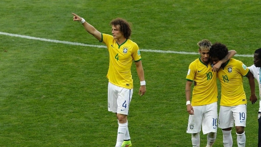 Brazil's David Luiz, Neymar and Willian, from left, leave the pitch after the World Cup round of 16 soccer match between Brazil and Chile at the Mineirao Stadium in Belo Horizonte, Brazil, Saturday, June 28, 2014. Brazil won 3-2 on penalties after the match ended 1-1 draw after extra-time.  (AP Photo/Hassan Ammar)