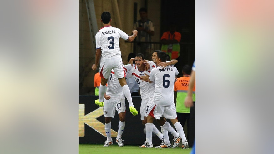 Costa Rica's Bryan Ruiz, center, celebrates with teammates after scoring the opening goal during the World Cup round of 16 soccer match between Costa Rica and Greece at the Arena Pernambuco in Recife, Brazil, Sunday, June 29, 2014. (AP Photo/Ricardo Mazalan)