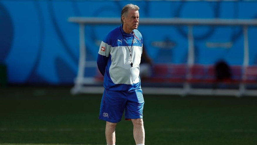 Switzerland's coach Ottmar Hitzfeld looks at players during a training session at Itaquerao Stadium in Sao Paulo, Brazil, Monday, June 30, 2014.  On Tuesday, Switzerland will face Argentina in their next World Cup soccer match. (AP Photo/Victor R. Caivano)